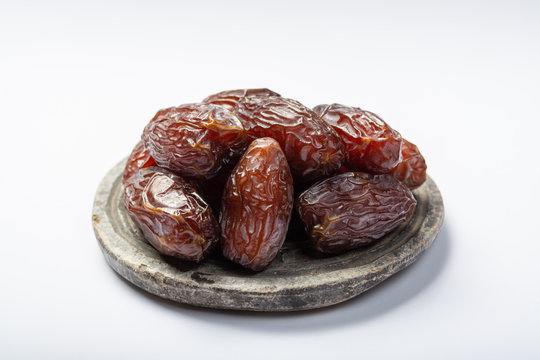 Pile of sweet tasty dried dates fruits close up isolated