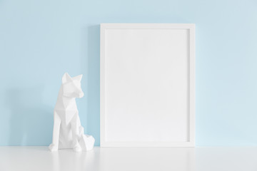 Frame and origami fox decor against bright blue wall mock up.