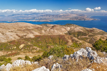 Aerial view over mountains to the rural road and Ionian sea, Pantokrator mountain foothill, Corfu, Greece