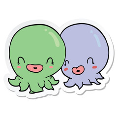 sticker of a two cartoon octopi