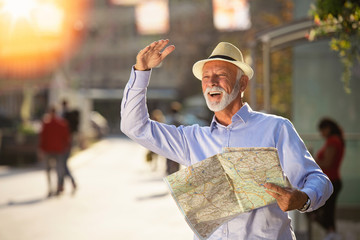 Happy smiling elder man tourist ready for journey, looking for direction.
