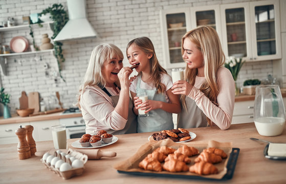 Daughter, mother and grandmother on kitchen
