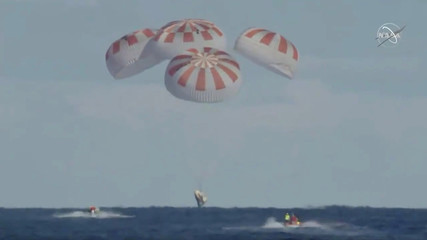 An unmanned capsule of the SpaceX Crew Dragon spacecraft splashes down into the Atlantic Ocean