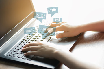 Woman hands using laptop for social media marketing and ecommerce concept.