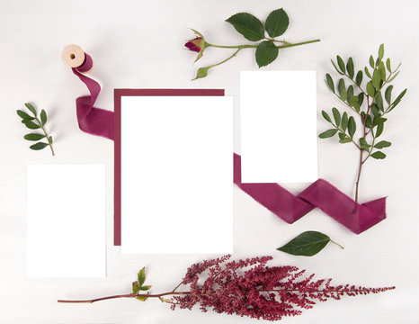 Burgundy wedding invitation mockup set with envelope and astilbe
