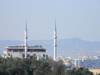 The minarets of a mosque with residential buildings in the background, Tirana, Albania