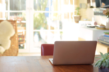 Unfolded laptop on a table for home office, homework, study or surfing the web