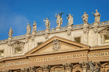 Wall Mural - Detail of the facade of St Peter's basilica in Vatican, Rome, Italy