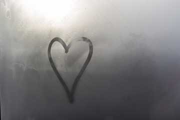 Heart with finger painted on a steam glass