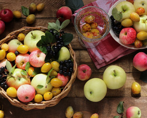 Village garden berries and fruits: apples, plums, chokeberry in the basket.