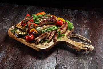 Assorted delicious grilled meat with vegetable on a barbecue. Grilled pork shish or kebab on skewers with vegetables . Food background shashlik