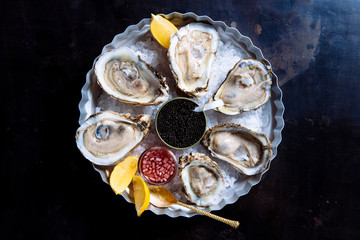 raw oysters with a side of caviar
