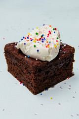 chocolate cake with whipped cream and sprinkles