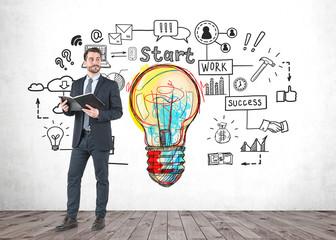 Businessman with planner, start up idea sketch