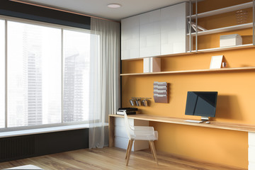 Yellow and gray home office with window