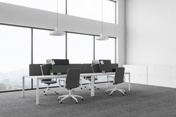 White open space office with windows
