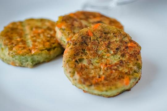 Vegetable patties on a white plate. Vegetarian food.