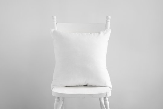 Mockup of white square cushion on white wooden vintage dining chair.
