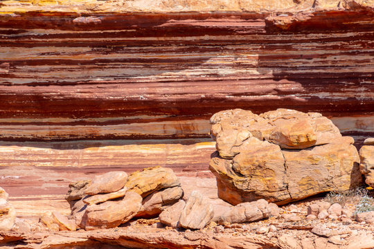 Different colored layers of sediment rock at the coast of Kalbarri National Park