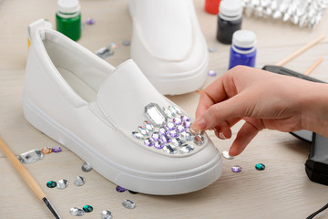 Girl adding rhinestones to shoes Wall mural