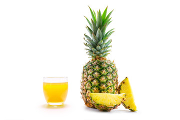 pineapple with slices isolated on white and a glass of pineapple juice.