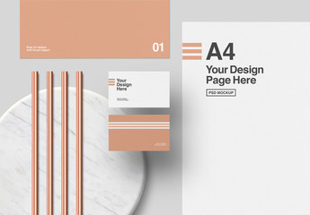 Stationery and Copper Elements on Marble and Gray Background Mockup