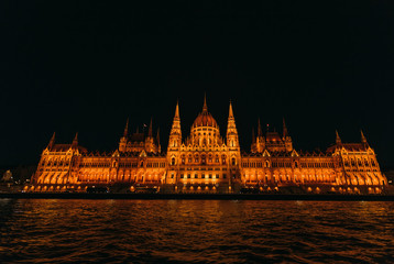 Budapest Parliament in Hungary at night. ripple on the river wat
