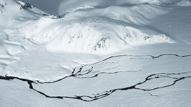 Rivers and streams winding through snowy Icelandic landscape