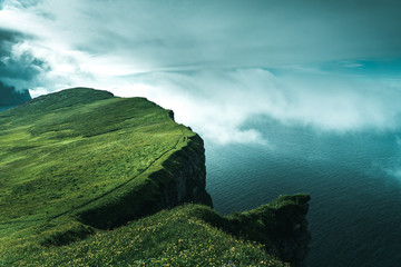 Dramatic view of Hornbjarg cliff over turquoise water, Iceland