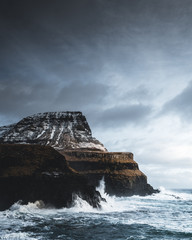 Waves break on the cliffs of the Westfjords, Iceland
