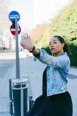 Woman taking a selfie in the street