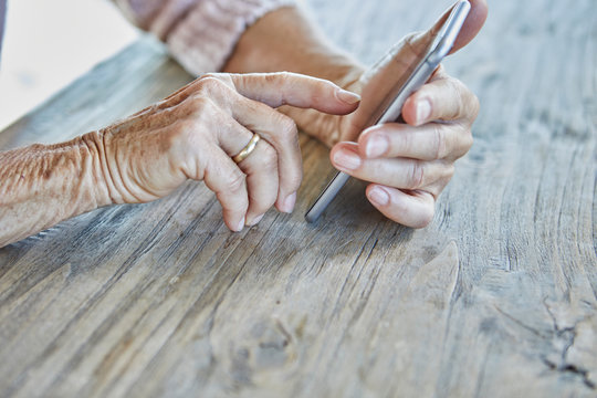 Woman's hands using smartphone, close-up