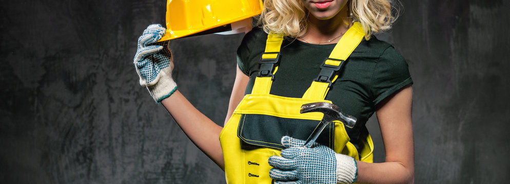 Cropped horizontal image builder woman with protective helmet