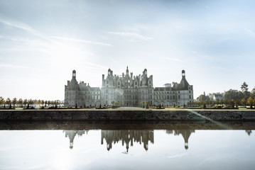 Chambord castle (chateau Chambord) in Loire valley, France. Ancient, famous and surprisingly beautiful, royal castle in France by the river. Reflection in water