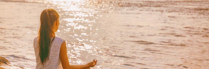 Obraz Yoga woman meditating on morning sunrise . Beach meditation banner panorama. - fototapety do salonu