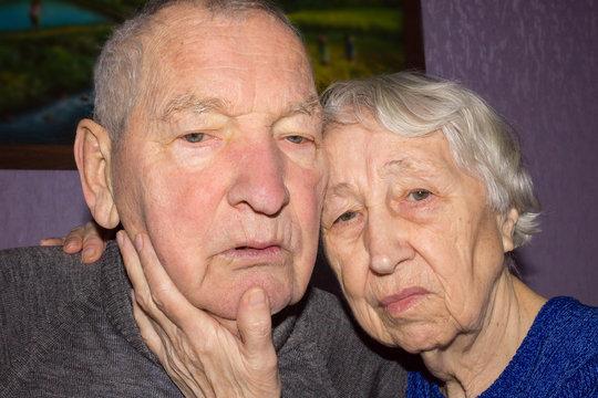 Portrait of a sad elder couple at home