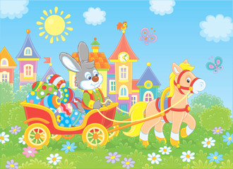 Poster Little grey rabbit carrying colorfully decorated Easter eggs in a cart with a small pony against the background of small town houses, vector illustration in cartoon style