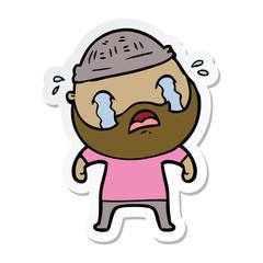 sticker of a cartoon bearded man crying