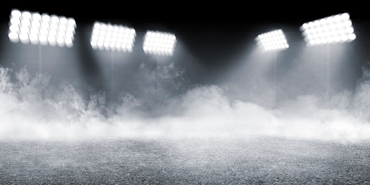 Sports arena with concrete floor with smokes and spotlights
