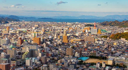 matsuyama city with Inland sea in background during sunset in Ehime Japan