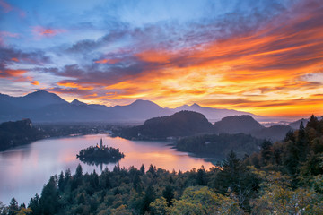 Dramatic sunrise sky over Lake Bled with the view of Village, Slovenia