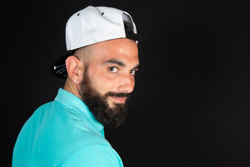 Saudi Arabian Muslim guy portrait on black background