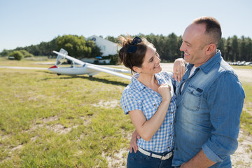 middle age couple in love with private plane