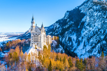 Beautiful view of world-famous Neuschwanstein Castle, the nineteenth-century Romanesque Revival...