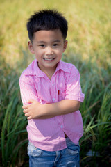 close up headshot of cheerful asian children toothy smiling face of happiness emotion
