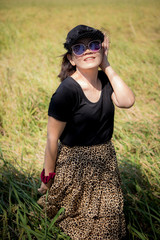 asian woman wearing sun glasses toothy smiling face happiness emotion standing outdoor