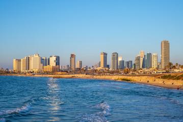 skyline of Tel Aviv, Israel by the beach at dusk