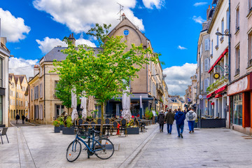 Old street with old houses and tables of cafe in a small town Chartres, France Fototapete
