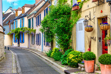 Old street with old houses in a small town Chartres, France