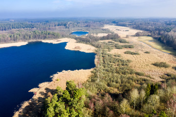 Flying above wonderful lake and forest, Poland